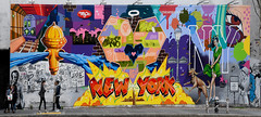 Houston & Bowery (Anthony Mark Images) Tags: wallmural painting urbanart art streetart boweryst houstonst newyork nyc manhattan bigapple people themuralkings lamppost womaningreendress dog waterhydrant newyorksubway fence nikon d850 flickrclickx colourful