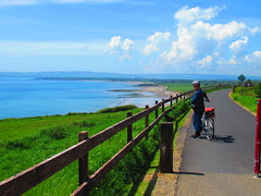 Dungarvan in the Distance (sam2cents) Tags: landscape dungarvan waterford ireland seascape sea sand coast shore green blue greenway bike woman