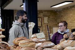 Bakery (oxfordblues84) Tags: machaneyehudamarket oat overseasadventuretravel jerusalemisrael jerusalem israel walkingtour market bread bakery man woman jews jewish jewishbakery handsome facialhair stud loaves loavesofbread
