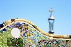 Guadi's mosaic palace (jgra9601) Tags: 4000d canon bright blurred streetphotography architecture sun bluesky cross colour mosaic gaudi barcelona parkgeull