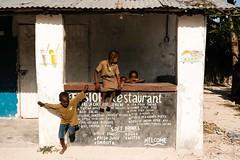 Hop ! We go ! (.sl.) Tags: jambiani people portrait streetphotograghy tanzanie zanzibar black africa tanzania street kid restaurant play village