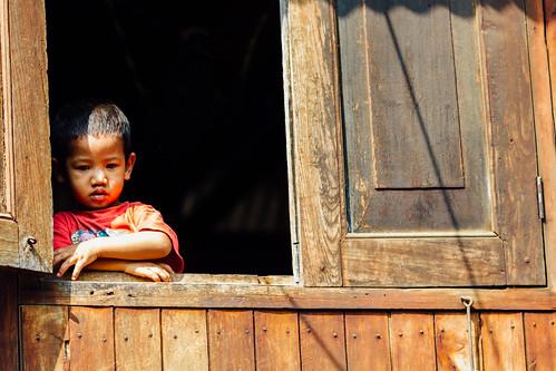 Boy Watching Nat Pwe from Window, Mandalay Myanmar