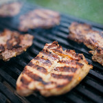 Grilled pork steak on a barbecue thumbnail