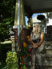 Who Could That Trashy Woman Be, Almost In Hiding? (Laurette Victoria) Tags: catsuit animalprint porch desiree woman blonde
