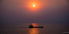 2019 - Thailand - Laem Chabang Sunset (Ted's photos - Returns 17 July) Tags: 2019 cropped laemchabang nikon nikond750 nikonfx tedmcgrath tedsphotos thailand vignetting sunset ship sun smog reflection sunreflection waterreflection