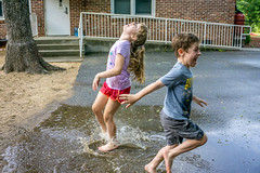 Happiness is a warm puddle (agasfer) Tags: 2019 southcarolina greenville kids children sony a6000 sonye3556pz1650oss