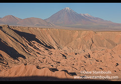 Licancabur volcano rises above the desert landscape in the Valle Marte, San Pedro de Atacama, Chile (jitenshaman) Tags: travel worldtravel destination destinations southamerica latinamerica chile atacama sanpedrodeatacama nortegrande desert altiplano plains mountain mountains volcano volcanoes peak landscape landscapes scenery nature outdoors natural view vista vallemarte marsvalley moonscape colours colors colour color arid dry deserts rocks formations valley naturallandscape naturesbeauty beautiful desolate stark tourism touristattraction desertscape eerie moon wilderness licancabur
