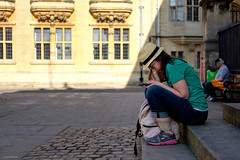 Concentration (Silver Machine) Tags: oxford oxfordshire streetphotography street candid girl sitting steps mobile phone stawhat fujifilm fujifilmxt10 fujinonxf35mmf2rwr