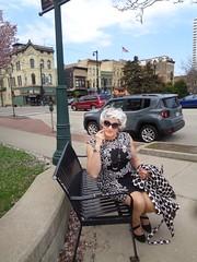 Lady In Waiting (Laurette Victoria) Tags: milwaukee downtown woman laurette dress raincoat silver sunglasses