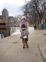 Greyhounds And Grey Lady In Downtown Milwaukee (Laurette Victoria) Tags: milwaukee downtown marquettepark woman laurette silver sunglasses dress