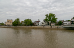 Sandusky River and Buildings — Tiffin, Ohio (Pythaglio) Tags: river water trees clouds tiffin ohio unitedstatesofamerica senecacounty houses dwellings residences buildings structures bridge riverfront sanduskyriver