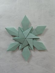 Cracovia - Monika Hanková I came up with this star during the Outdoor Origami Meeting last weekend in Kraków. It's not based on the same base as my other stars and that's why this one gets a special name from a wonderful origami convention. I wouldn't rat (Monika Hankova) Tags: origamisnowflake snowflake star paper tant origami paperfolding origamistar