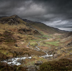 Ogwen valley pano (paullangton) Tags: wales ogwen valley snowdonia river rocks clouds vista landscape pano canon mountain trees