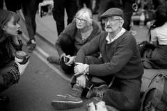 Grounded (Foto John) Tags: leica leicammonochrom246 leicammonochromtyp246 summiluxm35mmƒ14asphfle rangefinder streetphotography protest protesters demo demonstration woman women man people extinctionrebellion blackwhite blackandwhite blackandwhitethatsright monochrome truemonochrome london uk
