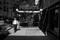 Fridays (streetravioli) Tags: street photography chicago tgi fridays side walk dining fresco al