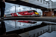 A reflection on the weather (Peter Leigh50) Tags: rain puddle reflection reflections footbridge dvt railway railroad rail water train track people weather may cloud lner fujifilm fuji xt2