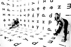 In between (Rosetta Bonatti (RosLol)) Tags: roslol rosettabonatti blackandwhite bw text words candid art mocak poland krakow cracow cracovia museum modern room letters people girl boy stanisław dróżdż