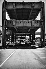 Aurora Viaduct Carcass Seattle (FrankieJoe) Tags: seattle cacass 99 aurora viaduct urban concrete demolition dark destruction new birth gotham bygone era change depression ilford black white fuji fujifilm xf27mm