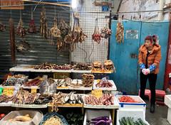 Market Girl (cowyeow) Tags: woman market streetmarket china asia asian guangdong guangzhou street candid meat fish