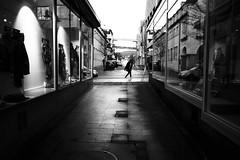 Showcase alley (Leica M6) (stefankamert) Tags: showcasealley leica m6 leicam6 kodak trix voigtländer ultron film analog grain tones mood people dark noir noiretblanc blackandwhite blackwhite bw stefankamert