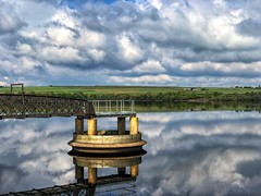 Blackmoorfoot (again!). (Mr_Pudd) Tags: grass reflection steel gantry bridge overflow drain water reservoir blackmoorfoot