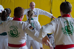Grandmaster Bill Strong leads a class (TheBurgners) Tags: tournament wtsda sanfrancisco missionhigh paresh tang soo do