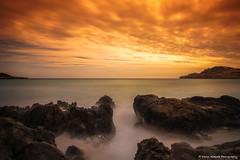 Spanish LE Sunset (Yarin Asanth) Tags: effect silky smooth surface water mist fog orange coast beach rocks baleares mallorca spain le longexposure gerdkozik yarinasanth