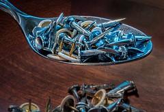 A Spoonful Of... (Wes Iversen) Tags: aspoonfulof hmm macro macromondays tokina100mmf28atxprod chrome gold nails silver spoons thumbtacks wood woodgrain