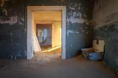 In the Ghost Town of Kolmanskop, Namibia (ansharphoto) Tags: abandoned africa african architecture barren blue building city climate color colour decayed demolition desert diamond door doorway drought dry dune empty environment german ghost green haunted historical history home house iconic interior kolmanskop kolmanskuppe landmark light luderitz namib namibia old orange red ruin sand shadow town travel urban view wall