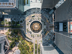 Top view of the Fountain of Wealth as the largest fountain in the world at Singapore. It is located in one of Singapore largest shopping malls. (MongkolChuewong) Tags: aerial aerialview air architecture art asia bridge building circle city cityscape color downtown drone famous finance fly fountain harbor high junction landmark landscape largest located malls modern night ocean office performance rich ring shopping show singapore singaporecity skyscraper structure suntec tall top tourism tower town travel urban view water wealth