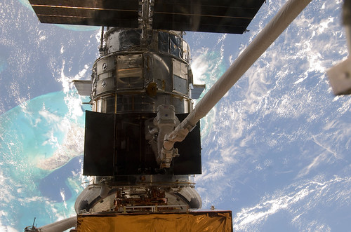 STS-125 MS5 Feustel and MS3 Grunsfeld during EVA3