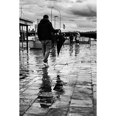 Rainy day (Kebeard) Tags: street fujifilm lake geneva genf monochrom white black umbrella puddles rain reflections