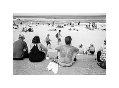 Manly beach, Sydney 2019  #830 (lynnb's snaps) Tags: apx100 olympusom4ti rodinal bw blackandwhite film tattoo man 2019 35mmfilm 35mmblackandwhite omzuiko28mmf2 agfaapx100 manlybeach sydney australia beach ocean coast swimmers waves bianconegro biancoenero blackwhite bianconero blancoynegro noiretblanc schwarzweis monochrome ishootfilm filmneverdie