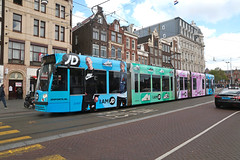 Damrak - Amsterdam (Netherlands) (Meteorry) Tags: europe nederland netherlands holland paysbas noordholland amsterdam centrum center centre damrak siemens combino 13g jssports sneakers trainers baskets promotion commercial livery tram streetcar tramway public transport publique transportencommun transit gvb gvb2107 gvb14 nike airmax95 nikeairforce dutch may 2019 meteorry