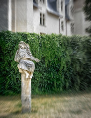 Angelic music (Tigra K) Tags: montreuilbellay maineetloire france 2010 carving castle column face garden gothic museum palace plant sculpture statue vine art
