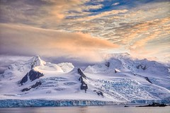 Antarctic mountains at sunset over water