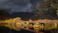 The Old Railway Bridge (Questions Of Light Photography) Tags: railway bridge old fall autumn water trees scotland loch awe scottish highlands argyll bute storm canon reflection