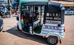 2019 - Cambodia - Sihanoukville - Phsar Leu Market  - 19 of 25 (Ted's photos - Returns late November) Tags: 2019 cambodia cropped nikon nikond750 nikonfx tedmcgrath tedsphotos vignetting tuktuk phsarleumarket phsarleumarketsihanoukville sihanoukvillecambodia sihanoukville taxi street streetscene shadow ride motorcycle helmut wheels