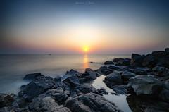 Solivagant Thoughts (_Amritash_) Tags: solivagantthoughts sunset sunsetlights sunsetcolors sunsetsky sea seascape seaside arabiansea ratnagiri rocks longexposure longexposurejunkie longexposureseascape