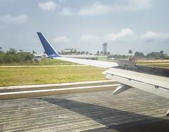 Look! Beer! - Arriving in Belize City (Jonmikel & Kat-YSNP) Tags: belize vacation belizecity brewery airport jet plane runway
