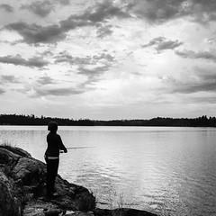 Gone Fishin' (Aaron Bieleck) Tags: hasselblad500cm 120film analog 6x6 square film filmisnotdead hasselblad mediumformat wlvf sarah boundarywaters fishing mn minnesota lake bw blackandwhite 60mmct clouds outdoors