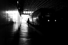 Behind lighthouses (pascalcolin1) Tags: paris13 homme man gare garedausterlitz station lumière light ombre shadows train phares lighthouse photoderue streetview urbanarte noiretblanc blackandwhite photopascalcolin 50mm canon50mm canon