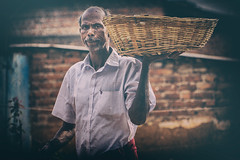 Guess (Rajiv Lather) Tags: street photography kerala basket guess portrait character india smile