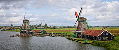 Windmills of Zaanse Schans (Brett of Binnshire) Tags: historicalsite on1raw zaandam netherlands clouds river manipulations water locationrecorded architecture windmill museum weather 2391 zaanseschans stream northholland