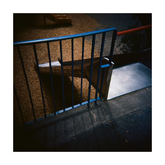 playground fence (Armin Fuchs) Tags: arminfuchs lavillelaplusdangereuse holga film analog mittelformat mediumformat 6x6 120mm square diagonal fence light hff kodakektar