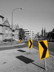 North Adelaide (Anthony Kernich Photo) Tags: adelaide city cityscape urban streetscape northadelaide australia australian southaustralia sa kingwilliamstreet town street olympusem10 olympus olympusomd microfourthirds selectivecolor spotcolor selectivecolour outdoor outside flickr autumn monochrome blackwhite bw grayscale sign chevron travel shadow