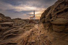 Favaritx Lighthouse - Sunset Worlds (Max W!nter) Tags: favaritx lighthouse menorca sunset sonnenunergang leuchtturm faro rocks rocky traces leads sky colorful orange blue wonders lights golden hour excursion photopills closetotheground wideangle nikon nikkor may evening