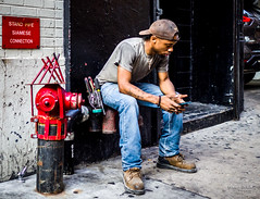 The New Yorkers - Worker (François Escriva) Tags: street streetphotography us usa nyc ny new york people candid olympus omd photo rue sun light man colors sidewalk manhattan worker blue red phone rest standpipe cap