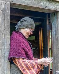 Pulling Yarn (AChucksEyeView) Tags: old female world wisconsin rustic period door cabin