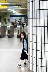 Little korean girl playing hide and seek in Metro (kitsunekuma) Tags: seoul korea korean streetphotography streetfood street fujifilm fujinon fuji 35mm xpro1 xf xf35mmf2 metro little girl playing playful hide hiding hideandseek fun